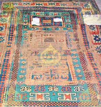 Antiker Kazak mit Löchern vor der Teppich-Restaurierung