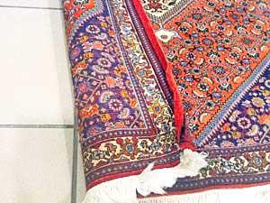 Eingerollte Teppichkanten brauchen Teppichrestaurierung